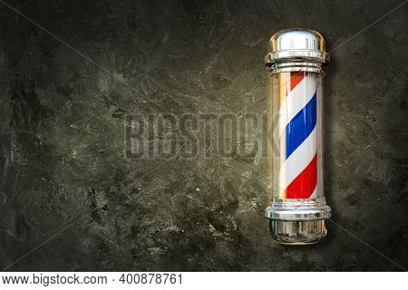 Barber Pole. Barbershop Pole On A Textured Background With Copy Space.
