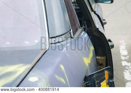Broken Car After The Accident Without Door, Closeup View. Totally Wracked Car After Accident. Body O