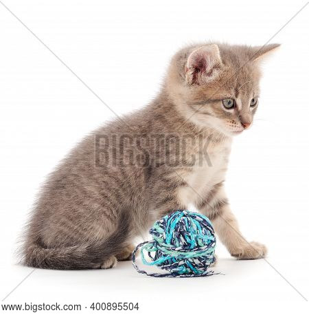 Kitten With Ball Of Yarn Isolated On White Background.