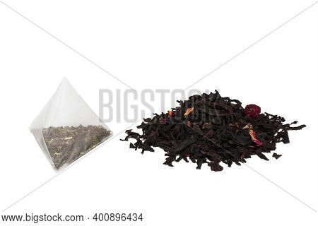 Dry Tea Leaves And Tea In A Tea Bag. The Concept Of Choosing Between Fast And Cheap Tea And Natural