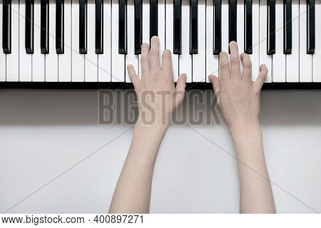 Play The Piano, Hands Close-up On The Keys Of The Synthesizer Top View, Music Learning, Music School