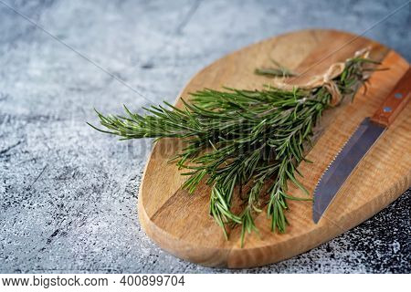 Raw Fresh Rosemary Leaves On A Background