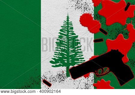 Norfolk Island Flag And Black Firearm In Red Blood. Concept For Terror Attack Or Military Operations