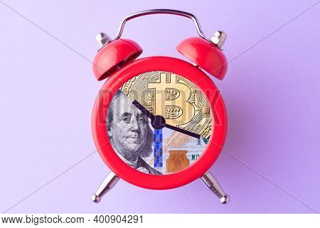 Bitcoin And Us Dollar Bill In Alarm Clock. Concept Of Deadline To Invest In Cryptocurrency. Time To