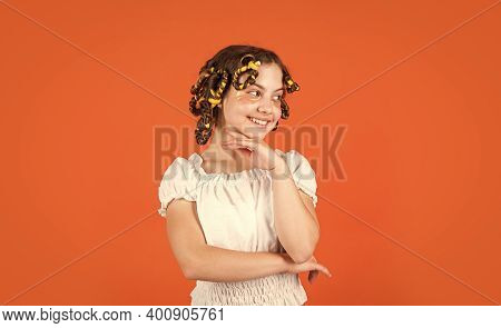 Child Making Hairstyle. Little Happy Girl With Curlers In Hair. Fabric Mask Under Eyes For Beauty. C
