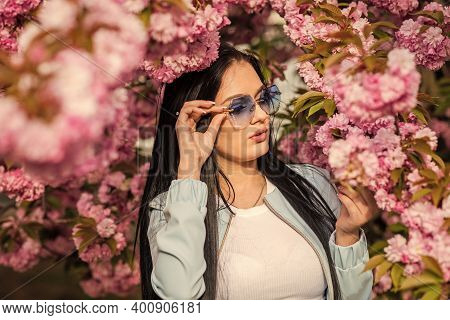Lifestyle And Fashion. Girl Enjoy Sakura Blossom. Woman In Cherry Bloom. Delicate Flowers Pink Flora