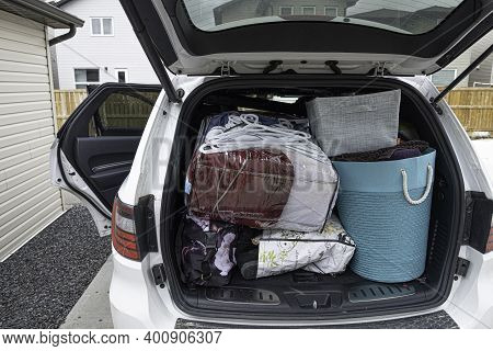April 18 2020 - Lethbridge Alberta Canada - Suv With Students Luggage At End Of Semester