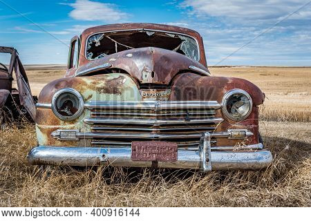 Swift Current, Sk- April 20, 2020:  Abandoned Vintage Green Plymouth Car On The Prairies In Saskatch
