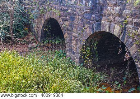 Augusta, Ga Usa - 12 12 20: Augusta Canal Trail Drain Tunnels And Green Foliage