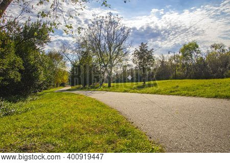 Augusta, Ga Usa - 12 12 20: Augusta Canal Trail Empty Paved Trail With Fall Foliage Along Side Of A