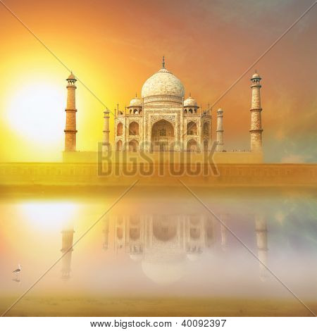 Taj Mahal India Sunset. Agra, Uttar Pradesh. Beautiful Palace with reflection in river. Wonderful landscape.