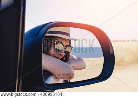 Happy Woman In Hat And Sunglasses On Summer Roadtrip
