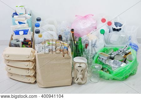 Recyclable Garbage: Glass, Different Plastic, Paper, Cardboard, Metal Prepared For Recycling. Waste