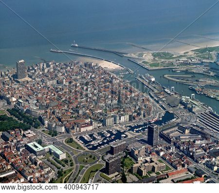Belgium, Ostend, June 14 - 1986: Historical aerial photo of the the city Oostende, a coastal city and municipality, located in the province of West Flanders in the Flemish Region of Belgium.