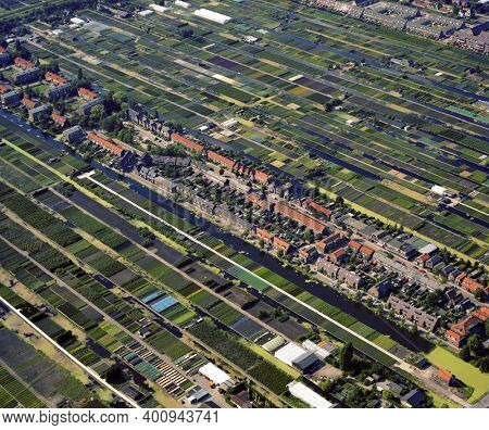 Boskoop, Holland, August 01 - 1986: Historical aerial photo of the tree nurseries, arboriculture and canals of Boskoop in the province Zuid Holland