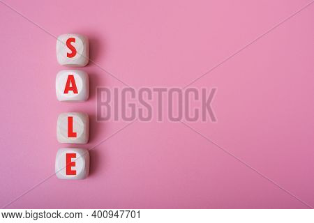 Word Sale On Wooden Cubes, Pink Background, Place For Text.