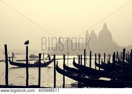 Romantic Italian City Of Venice, A World Heritage Site: Traditional Venetian Wooden Boats, Gondolier