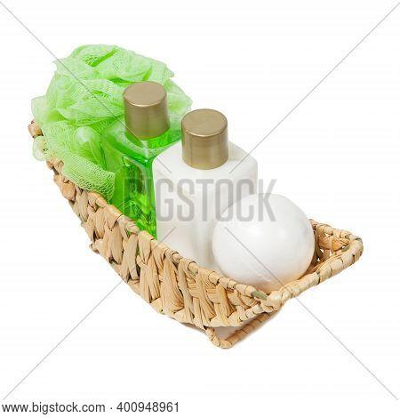 Body Care Cosmetics, Sea Salt, Body Lotion, Shower Gel, Washcloth In A Wicker Basket On Neutral Back