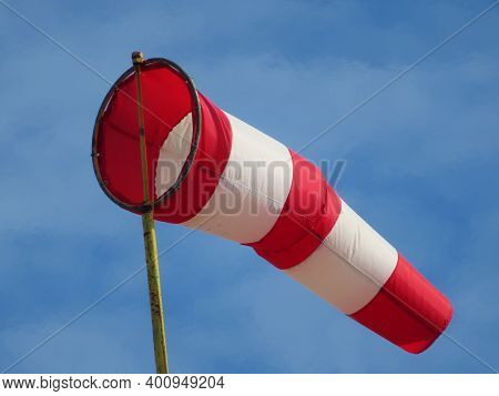 Windsock indicator of wind on runway airport. Wind cone indicating wind direction and force. Horizon