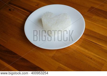 Heart Shaped Steamed Rice In White Plate