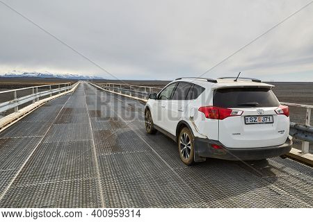 RING ROAD 1, ICELAND - CIRCA 2015: Toyota RAV4 AWD four wheel drive SUV used in Iceland. Single-lane bridge with some wider space for cars to pass each other by. One-lane bridges are common in Iceland