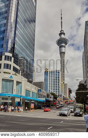 Auckland, New Zealand - Circa 2016: Street view in Auckland city center with the Sky Tower, tall telecommunication tower with an observation deck