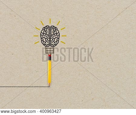 Yellow Pencil With Brain And Light Bulb Metaphor For Creative And New Idea On Brown Recycled Backgro