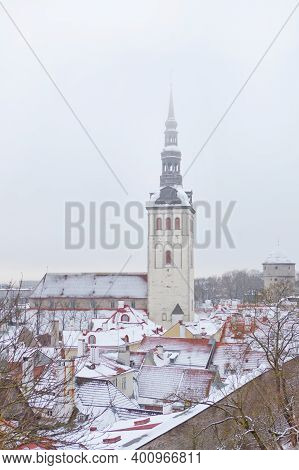 Old Town Of Tallinn In Estonia. Vertical Photo Of St. Nicholas Church, Niguliste Facade And Roofs Of