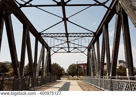Looking Through Pedestrian Bridge On Cherry Creek Trail In Downtown Denver.  Denver, Colorado, Usa