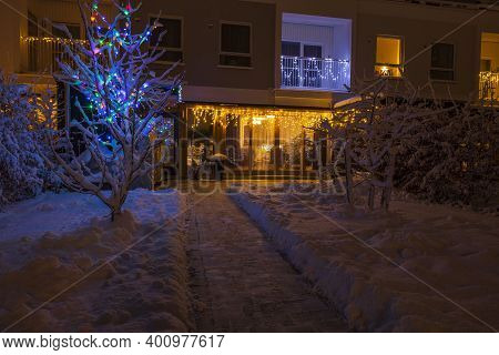 Beautiful Exterior View Of  Christmas Decorated Townhouse On Warm December Evening. Sweden. Europe.