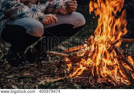 Teenager Girl Kindles Big Fire In Forest. Danger Of Wildfire. Environmental Protection. Dangerous Bo