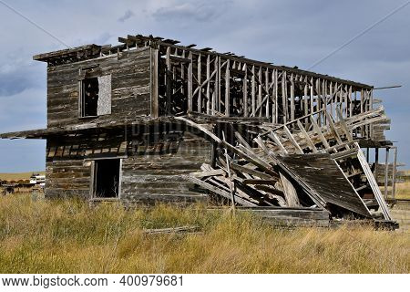 A Deserted Two Story Building In A Prairie Ghost Town Setting Has Fallen Into Total Ruins