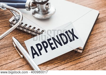 Appendix - Text On Card On Wooden Table With Stethoscope And Notepad For Medical Records.