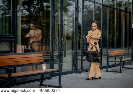 Business Women Style. Woman With Briefcase Going To Work. Portrait Of Beautiful Smiling Female In St