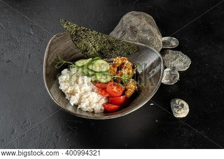 Teriyaki Chicken With Rice And Vegetables. A Hot Main Course With Chicken Fillet, Boiled Rice, Cucum