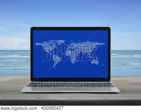 Start Up 2021 Business Icon With Global Words World Map With Modern Laptop Computer On Wooden Table