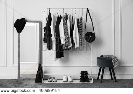 Rack With Stylish Clothes In Modern Dressing Room