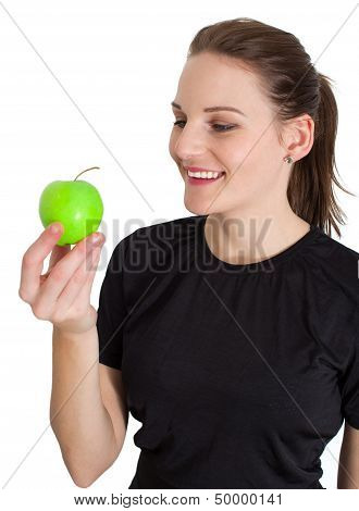 Woman Holding A Green Apple And Smiling