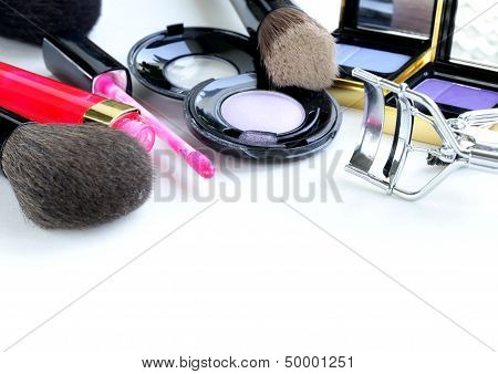 Makeup set (shadows, lipstick, brush) on a white background
