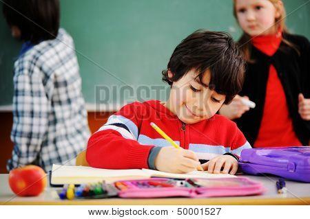 Cute lovely school children at clasroom having education activities