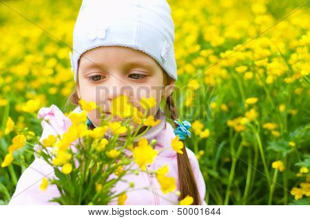 Girl Sniffing Yellow Flowers