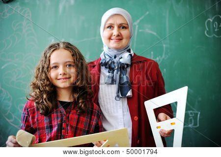 Cute lovely Arabic school children at classroom having education activities