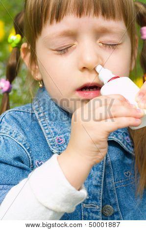 Girl Spraying Nose