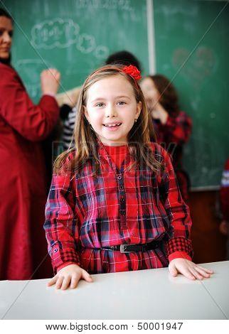 Cute lovely school children at classroom having education activities
