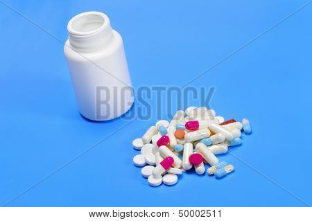 Capsules Spilling From A  Medicine Bottle