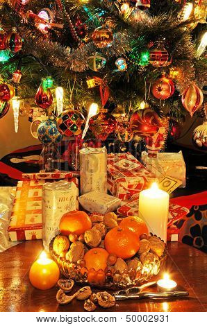 Fruit and nuts with Christmas tree