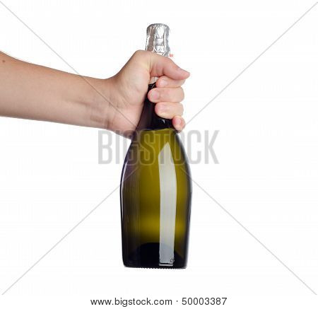 Hand holding bottle of champagne isolated on white
