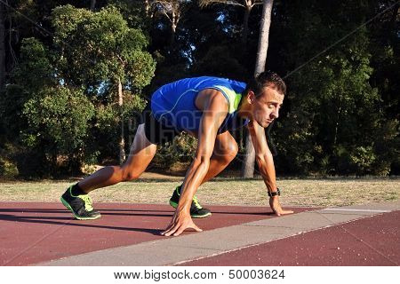 Young Athlete in Starting Position for a Race