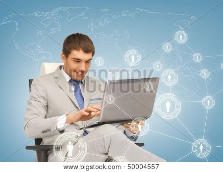 business, technology, internet and networking concept - businessman networking with laptop pc and virtual screens