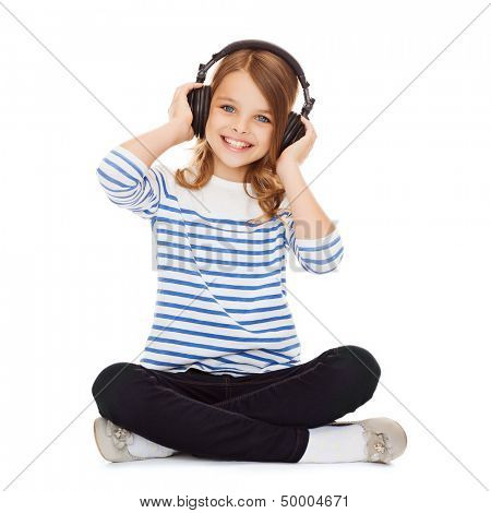 music and technology concept - child with headphones